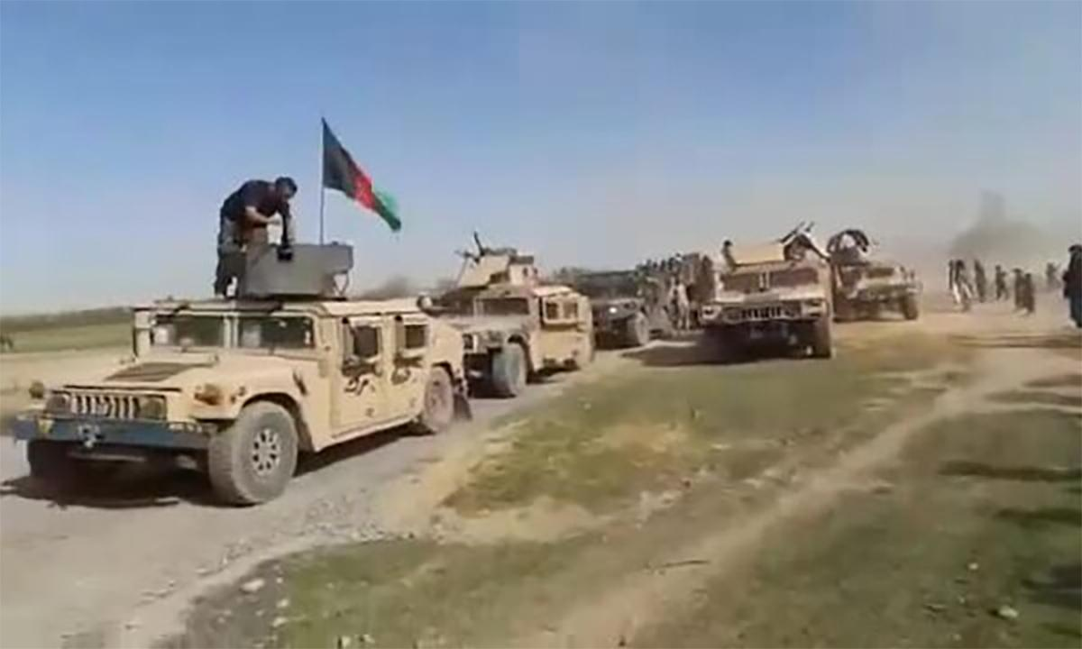 Taliban with armored vehicles