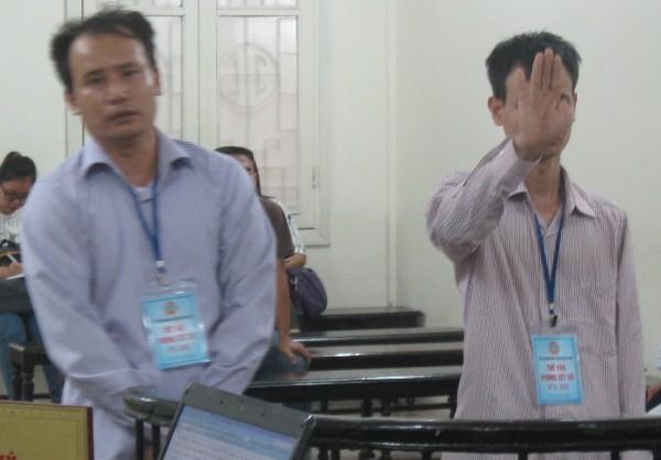 Hai anh em bị cáo Nguyễn Hữu Thật tại phiên tòa phúc thẩm