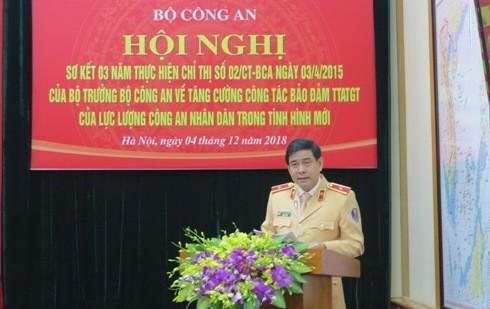 Thiếu tướng Vũ Đỗ Anh Dũng - Cục trưởng Cục Cảnh sát giao thông (Bộ Công an) trình bày báo cáo về 3 năm thực hiện Chỉ thị số 02/CT-BCA.