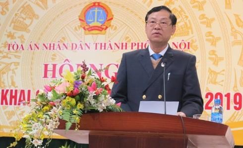 Chánh án TAND TP Hà Nội Nguyễn Hữu Chính báo cáo công tác năm 2018.