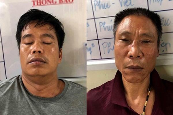 Trần Tuấn Hùng (bên phải) và đồng phạm ngay sau khi bị bắt giữ.
