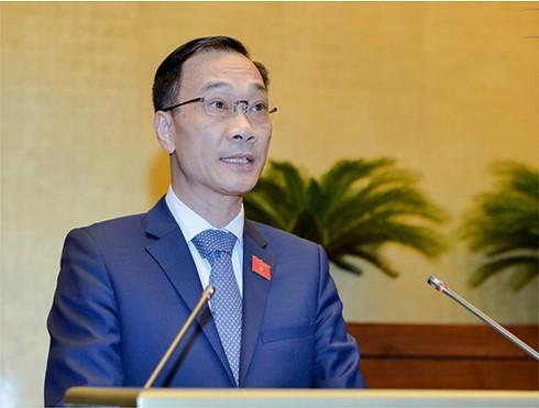 Chủ nhiệm Ủy ban Kinh tế của Quốc hội Vũ Hồng Thanh trình bày báo cáo thẩm tra Dự án Luật Quy hoạch