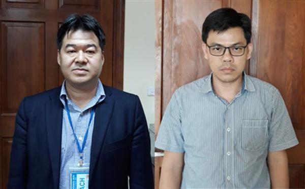 Bị can Nguyễn Hoài Giang (trái) và bị can Phạm Xuân Quang (phải)