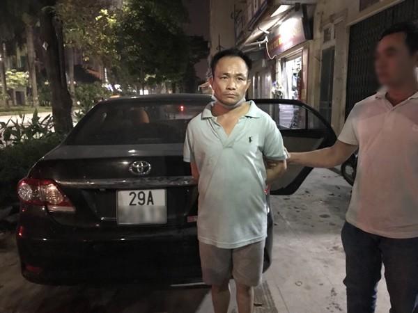 Nguyễn Bá Lam và chiếc xe ô tô có lốp dự phòng đựng đầy ma túy