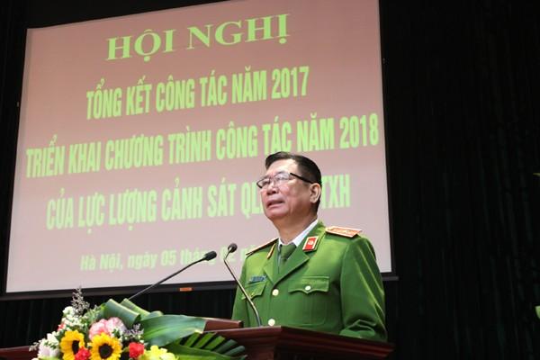 Thiếu tướng Đinh Văn Toản, Phó Giám đốc CATP chủ trì, phát biểu tại hội nghị