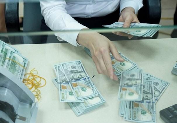 Dù tỷ giá tăng thời gian gần đây nhưng chuyên gia cho rằng nắm giữ tiền đồng vẫn có lợi