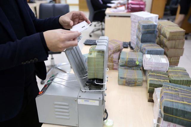 Ngân hàng Nhà nước giảm trần lãi suất huy động, lãi suất cho vay ngắn hạn đồng Việt Nam ảnh 1