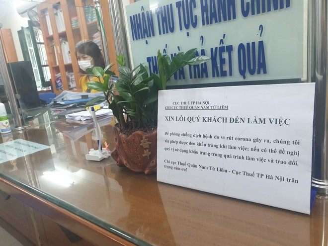 Sau lệnh tạm dừng tập trung trên 20 người, Cục Thuế Hà Nội kêu gọi nộp hồ sơ quyết toán thuế qua bưu điện ảnh 1