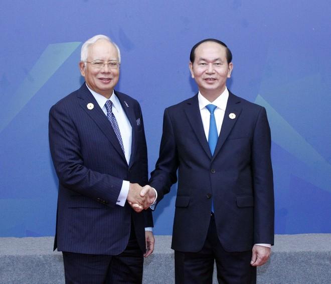 Chủ tịch nước Trần Đại Quang đón Thủ tướng Malaysia Najib Razak đến dự Đối thoại