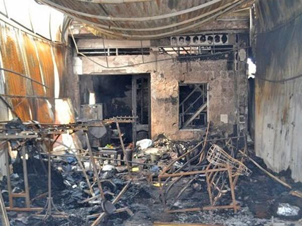 Người đàn ông chết cháy trong cửa hàng quần áo ảnh 1