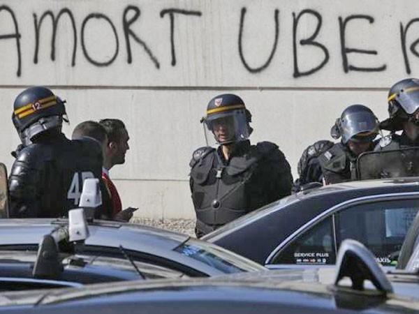 Tòa án Tối cao Pháp cấm dịch vụ taxi Uber giá rẻ ảnh 1