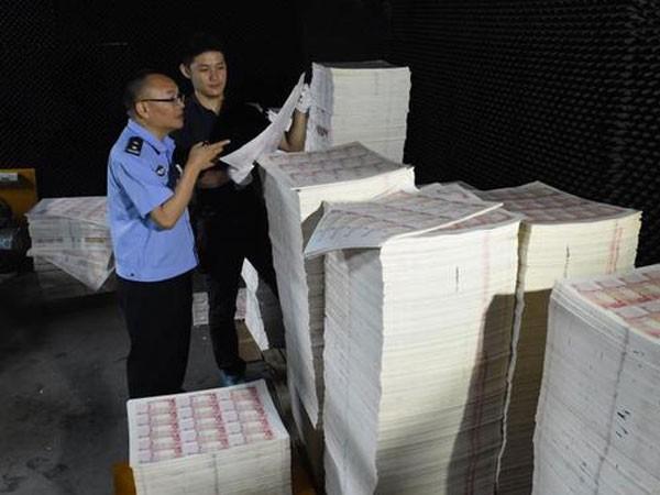 Trung Quốc triệt phá đường dây tiền giả chấn động Quảng Đông ảnh 1