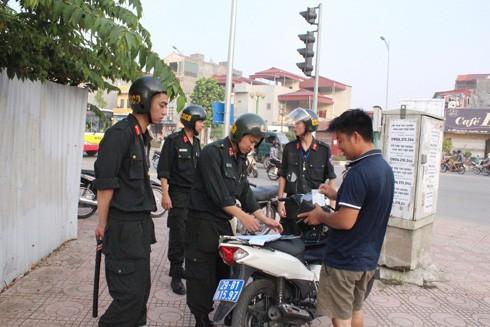Xử phạt 8.500 vi phạm liên quan đến mũ bảo hiểm trong 1 tháng ảnh 1