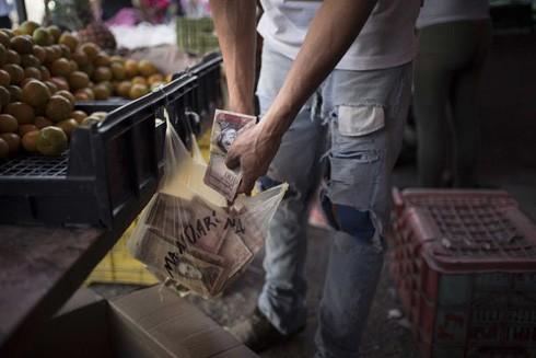 """Venezuela chống """"chiến tranh tiền tệ"""" ảnh 1"""