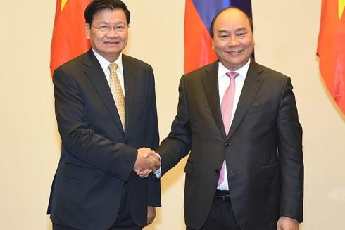 """Thủ tướng Lào """"xông đất Việt Nam"""" và họp Ủy ban liên Chính phủ hai nước ảnh 1"""