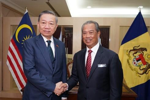 Bộ trưởng Bộ Công an Tô Lâm và Bộ trưởng Bộ Nội vụ Malaysia Muhyiddin Yassin
