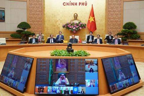 Thủ tướng Nguyễn Xuân Phúc dự họp thượng đỉnh trực tuyến G20 ứng phó Covid-19 ảnh 1