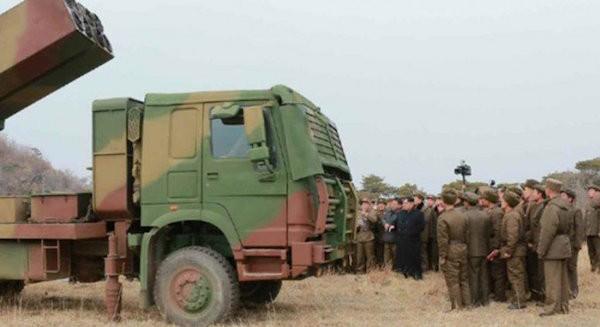 Triều Tiên công bố ảnh thử nghiệm tên lửa bắn loạt 300mm mới ảnh 2
