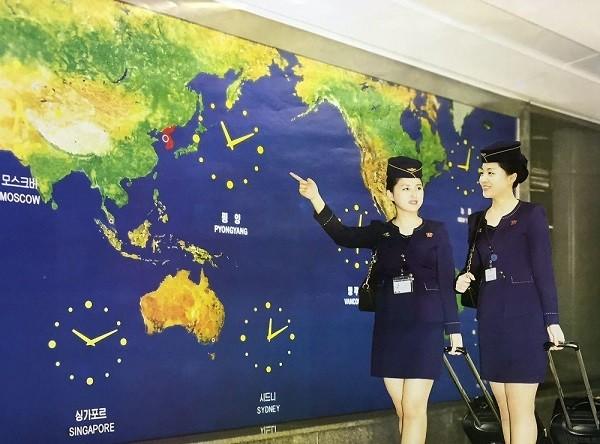Tiếp viên hàng không Triều Tiên đẹp long lanh trong bộ lịch 2017 ảnh 11
