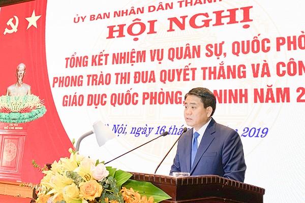Phó Bí thư Thành ủy, Chủ tịch UBND TP Nguyễn Đức Chung phát biểu tại hội nghị