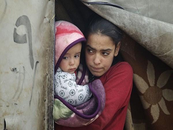 Người dân Syria khốn cùng trong đói khát, chết chóc, thời tiết khắc nghiệt ảnh 8