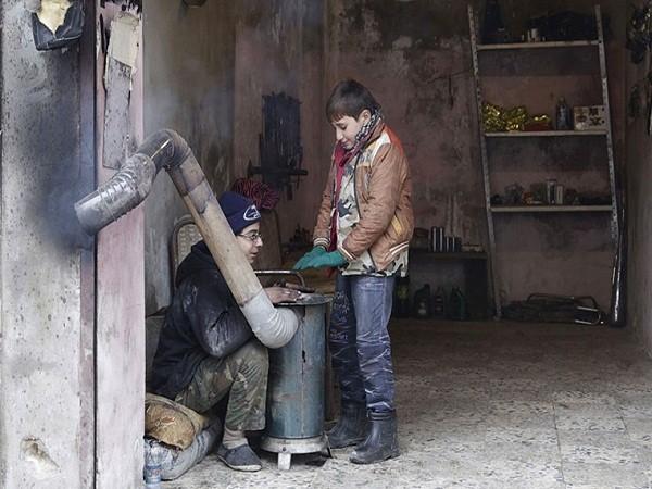 Người dân Syria khốn cùng trong đói khát, chết chóc, thời tiết khắc nghiệt ảnh 4