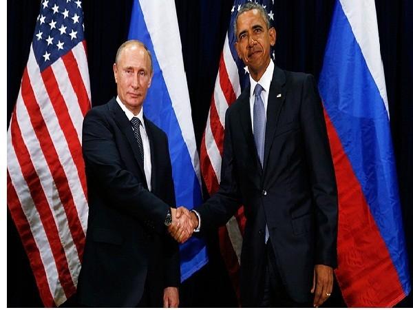 Tổng thống Nga Vladimir Putin (bên trái) và người đồng cấp Mỹ Barack Obama