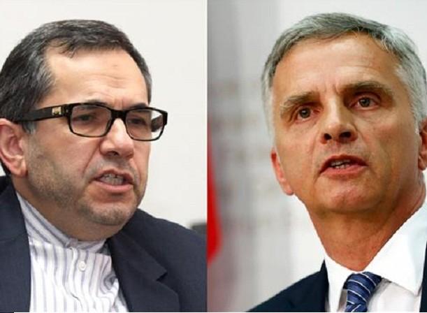 Bộ trưởng Bộ Ngoại giao Thụy Sĩ Didier Burkhalter (phải) và Thứ trưởng Ngoại giao Iran phụ trách các vấn đề Âu - Mỹ, ông Majid Takht-e Ravanchi