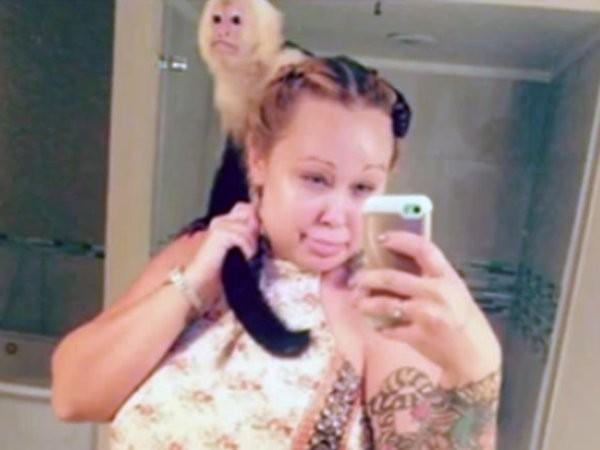 Mỹ: Để hổ đi lại trong nhà, bà mẹ bị cảnh sát bắt giữ ảnh 2