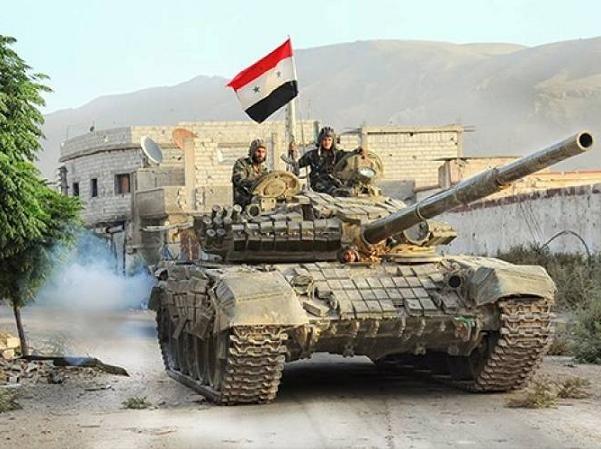 Quân đội Syria đang phải căng mình chống lại sức tấn công mạnh mẽ của IS ở Palmyra