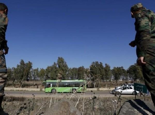 Phiến quân ở Homs đầu hàng quân đội Syria ảnh 1