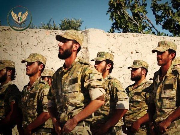 Bùng phát cuộc chiến giữa các nhóm phiến quân sau khi HTS chiếm thêm 2 thị trấn từ NLF ảnh 1