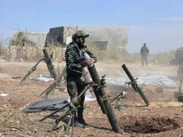 Binh sĩ SAA chuẩn bị một cuộc tấn công vào căn cứ của phiến quân ở vùng nông thôn tỉnh Hama, ngày 11-5-2019