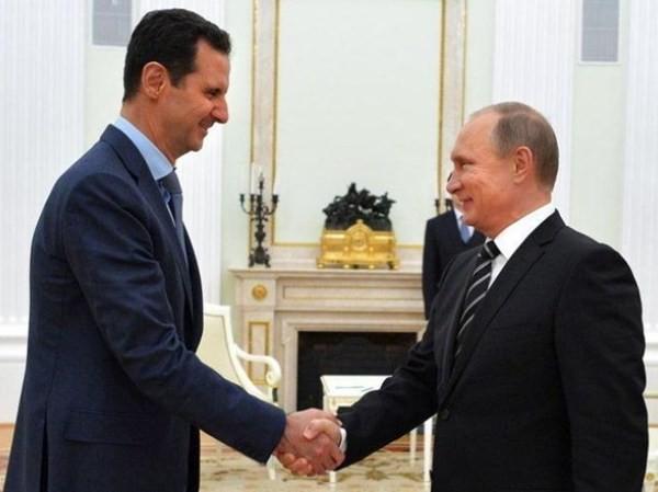 Tổng thống Syria Bashar al-Assad (trái) và người đồng cấp Nga Vladimir Putin