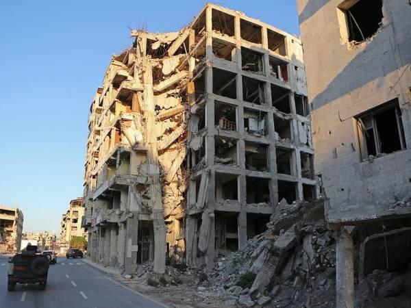 Các tòa nhà ở Idlib bị hư hỏng nặng do cuộc chiến giữa SAA và phe đối lập gây ra
