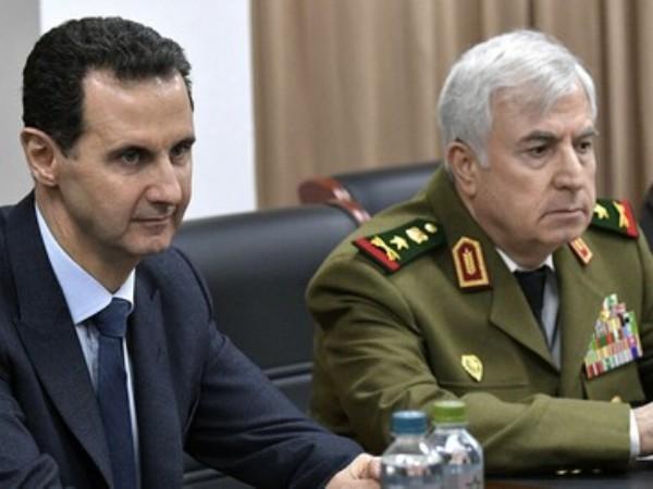Tổng thống Syria Bashar Assad (trái) và Bộ trưởng Quốc phòng Syria Ali Abdullah Ayoub