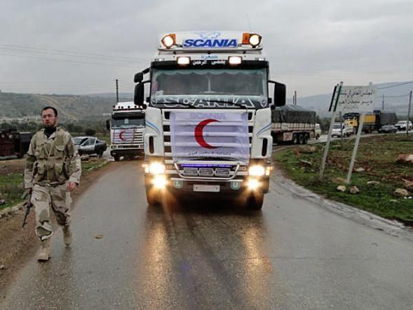 Đoàn xe chở hàng viện trợ nhân đạo của Hội Chữ thập đỏ và Trăng lưỡi liềm đỏ quốc tế đến trợ giúp Syria