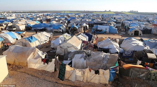 Cuộc sống ngập ngụa trong bùn của người tị nạn Syria ảnh 10