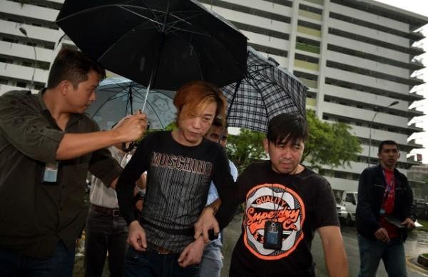 Lim bị cảnh sát Singapore giải đi sáng 20-11-2014