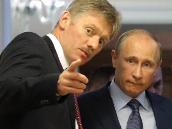 Ông Peskov (trái) bác bỏ mọi cáo buộc liên quan tới Tổng thống Nga Putin