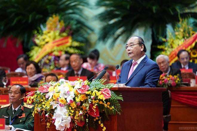 Thủ tướng Nguyễn Xuân Phúc phát biểu tại lễ khai mạc Đại hội đại biểu toàn quốc Mặt trận Tổ quốc Việt Nam lần thứ IX, sáng 19-9. Ảnh: Quang Hiếu