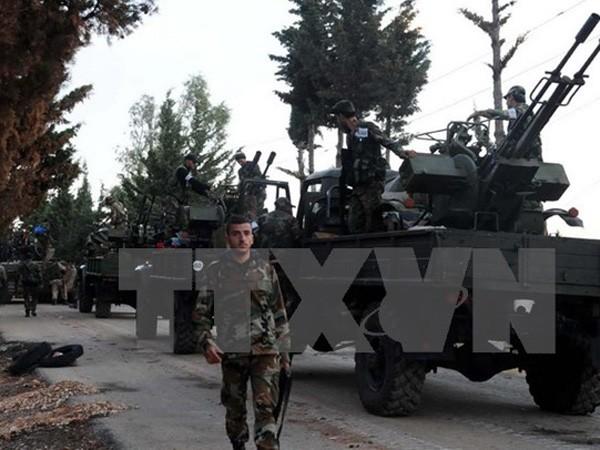 Binh sỹ Syria làm nhiệm vụ trong một chiến dịch ở miền Tây nước này ngày 8-10. Ảnh: TTXVN