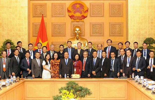 """Thủ tướng Nguyễn Xuân Phúc gặp mặt các doanh nghiệp có sản phẩm đạt giải thưởng """"Thương hiệu Quốc gia"""" năm 2018 tại trụ sở Chính phủ"""