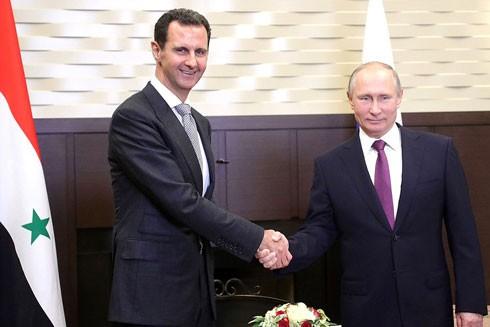 Tổng thống Nga Vladimir Putin (phải) hội đàm với Tổng thống Syria Bashar al-Assad tại Matxcơva ngày 21-11