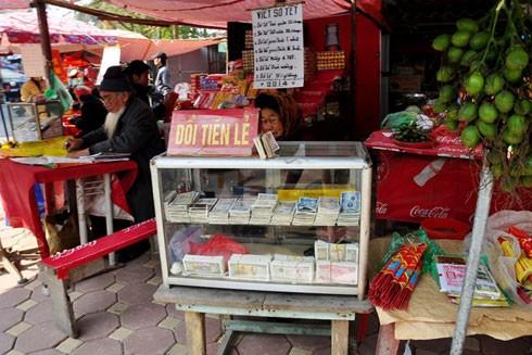Hiện tại việc nhận đổi tiền mới, tiền lẻ ăn chênh lệch là hoạt động bị cấm