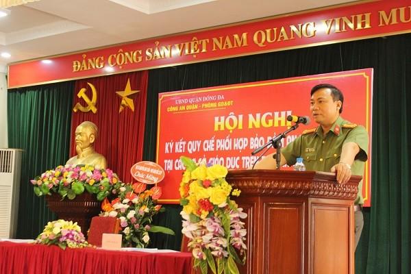 Trung tá Nguyễn Tiến Đạt, Phó Trưởng CAQ Đống Đa thông qua quy chế phối hợp