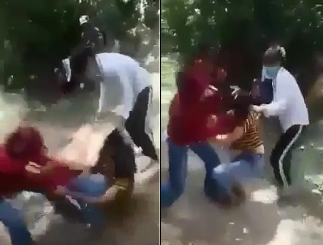 Hình ảnh hai nữ sinh đánh bạn trong rừng (ảnh cắt từ clip)