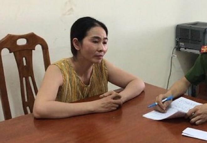 Phạm Thị Hương tại cơ quan công an (ảnh: BNA)