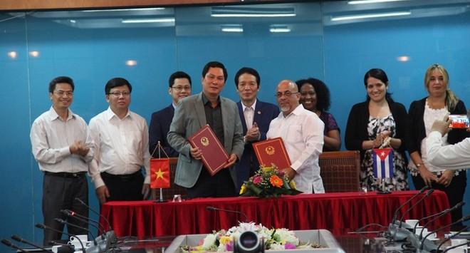 Việt Nam – Cuba ký biên bản ghi nhớ hợp tác trong lĩnh vực xuất bản ảnh 1