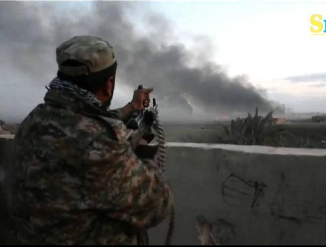 SDF giảm nhịp độ tấn công căn cứ cuối cùng IS để bảo vệ dân thường ảnh 1